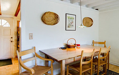 Dining area with country table seats four.