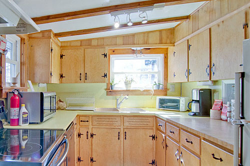 Fully Outfitted Kitchen With Cookware Dishes And Place Settings Provided
